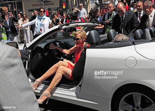 Princess Charlene of Monaco and Prince Albert of Monaco alight from a car before the Monaco Formula One Grand Prix at the Circuit de Monaco in Monte...