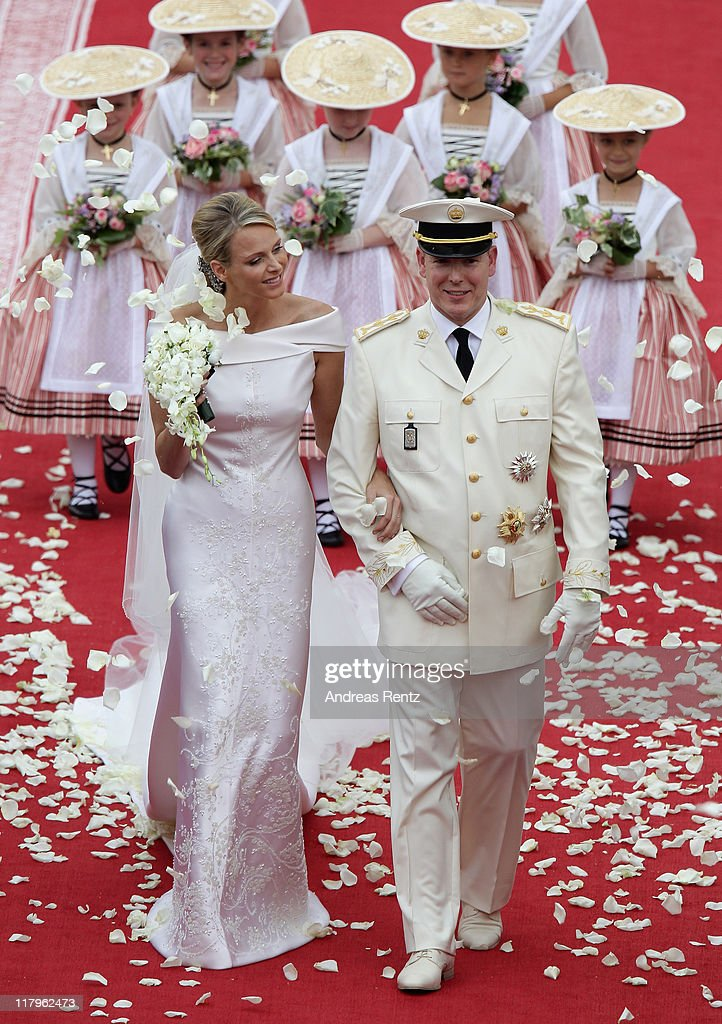 Princess <a gi-track='captionPersonalityLinkClicked' href=/galleries/search?phrase=Charlene+-+Princess+of+Monaco&family=editorial&specificpeople=726115 ng-click='$event.stopPropagation()'>Charlene</a> of Monaco and Prince Albert Of Monaco smile as they leave the palace after the religious ceremony of the Royal Wedding of <a gi-track='captionPersonalityLinkClicked' href=/galleries/search?phrase=Prince+Albert+II+of+Monaco&family=editorial&specificpeople=201707 ng-click='$event.stopPropagation()'>Prince Albert II of Monaco</a> to <a gi-track='captionPersonalityLinkClicked' href=/galleries/search?phrase=Charlene+-+Princess+of+Monaco&family=editorial&specificpeople=726115 ng-click='$event.stopPropagation()'>Charlene</a> Wittstock in the main courtyard at Prince's Palace on July 2, 2011 in Monaco, Monaco. The Roman-Catholic ceremony follows the civil wedding which was held in the Throne Room of the Prince's Palace of Monaco on July 1. With her marriage to the head of state of the Principality of Monaco, <a gi-track='captionPersonalityLinkClicked' href=/galleries/search?phrase=Charlene+-+Princess+of+Monaco&family=editorial&specificpeople=726115 ng-click='$event.stopPropagation()'>Charlene</a> Wittstock will become Princess consort of Monaco and gain the title, Princess <a gi-track='captionPersonalityLinkClicked' href=/galleries/search?phrase=Charlene+-+Princess+of+Monaco&family=editorial&specificpeople=726115 ng-click='$event.stopPropagation()'>Charlene</a> of Monaco. Celebrations including concerts and firework displays are being held across several days, attended by a guest list of global celebrities and heads of state.