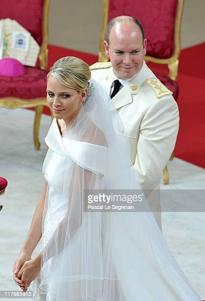 Princess Charlene of Monaco and Prince Albert Of Monaco smile during the religious ceremony of the Royal Wedding of Prince Albert II of Monaco to...