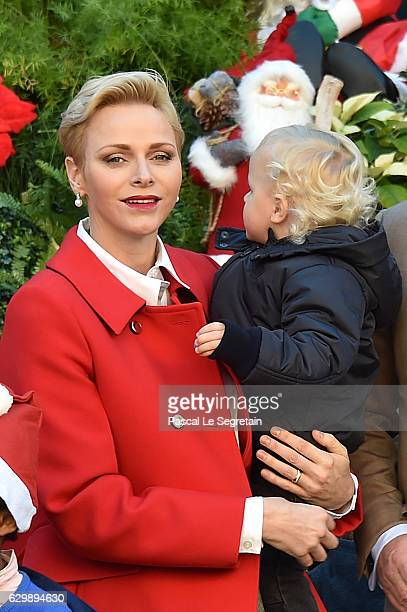 Princess Charlene of Monaco and Prince Jacques attend the annual Christmas gifts distribution at Monaco Palace on December 14 2016 in Monaco Monaco