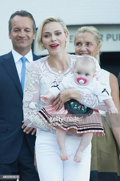 Princess Charlene of Monaco and Princess Gabriella arrive to attend the annual traditional 'Pique Nique Monegasque' on August 28 2015 in Monaco Monaco