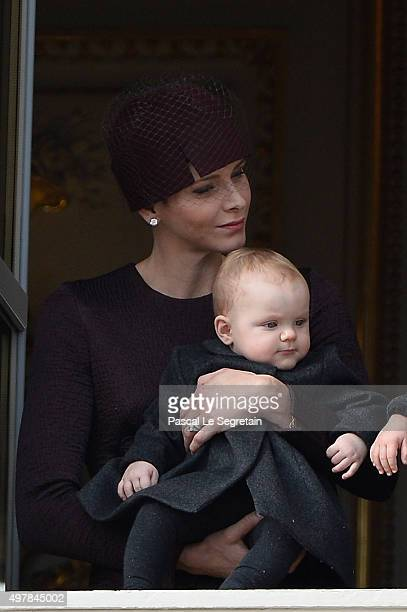 Princess Charlene of Monaco and Princess Gabriella greet the crowd from the palace's balcony during the Monaco National Day Celebrations on November...