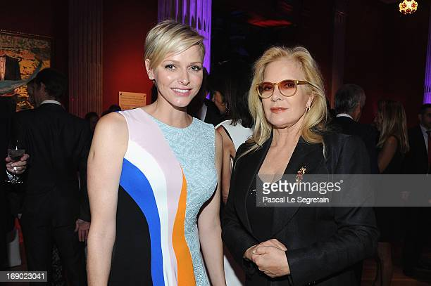 Princess Charlene of Monaco and Sylvie Vartan attend the Dior Cruise Collection 2014 cocktail on May 18 2013 in Monaco Monaco