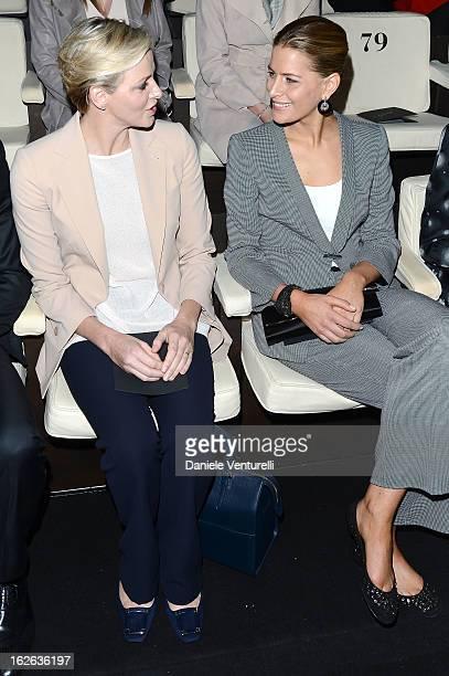 Princess Charlene of Monaco and Tatiana Blatnik attend the Giorgio Armani fashion show during Milan Fashion Week Womenswear Fall/Winter 2013/14 on...