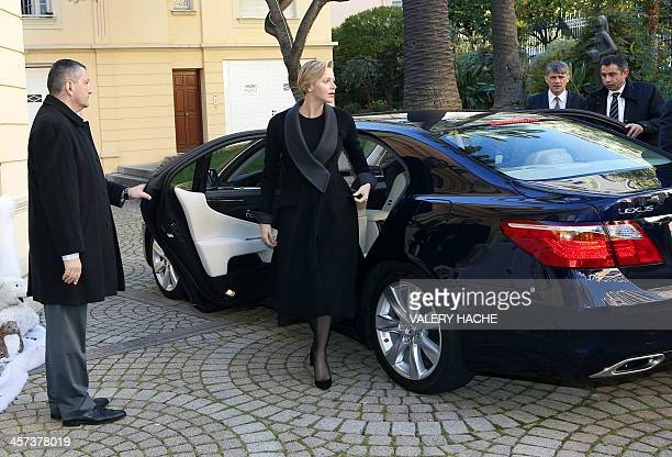 Princess Charlene of Monaco arrives to give Christmas presents to residents of Monaco on December 17 in Monaco AFP PHOTO / VALERY HACHE