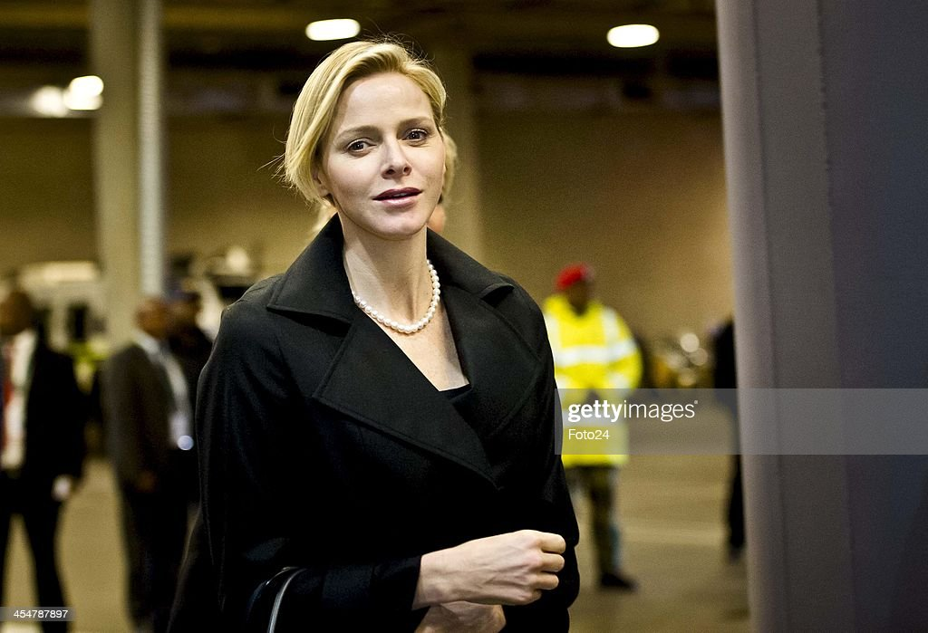 Princess <a gi-track='captionPersonalityLinkClicked' href=/galleries/search?phrase=Charlene+-+Princess+of+Monaco&family=editorial&specificpeople=726115 ng-click='$event.stopPropagation()'>Charlene</a> of Monaco attending Nelson Mandela's public Memorial Service at the FNB stadium on December 10, 2013, in Johannesburg, South Africa. The Father of the Nation passed away quietly on the evening of December 5, 2013 at his home in Houghton with family. He will be buried in Qunu for the official State funeral on December 15, 2013.
