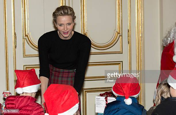 Princess Charlene of Monaco attends the Christmas gifts distribution at the palace on December 18 2013 in MonteCarlo Monaco