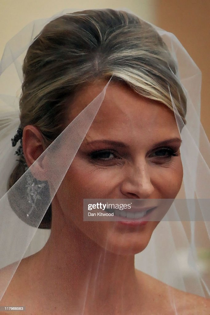 Princess <a gi-track='captionPersonalityLinkClicked' href=/galleries/search?phrase=Charlene+-+Princess+of+Monaco&family=editorial&specificpeople=726115 ng-click='$event.stopPropagation()'>Charlene</a> of Monaco attends the religious ceremony of the Royal Wedding of <a gi-track='captionPersonalityLinkClicked' href=/galleries/search?phrase=Prince+Albert+II+of+Monaco&family=editorial&specificpeople=201707 ng-click='$event.stopPropagation()'>Prince Albert II of Monaco</a> to Princess <a gi-track='captionPersonalityLinkClicked' href=/galleries/search?phrase=Charlene+-+Princess+of+Monaco&family=editorial&specificpeople=726115 ng-click='$event.stopPropagation()'>Charlene</a> of Monaco in the main courtyard at the Prince's Palace on July 2, 2011 in Monaco. The Roman-Catholic ceremony follows the civil wedding which was held in the Throne Room of the Prince's Palace of Monaco on July 1. With her marriage to the head of state of the Principality of Monaco, <a gi-track='captionPersonalityLinkClicked' href=/galleries/search?phrase=Charlene+-+Princess+of+Monaco&family=editorial&specificpeople=726115 ng-click='$event.stopPropagation()'>Charlene</a> Wittstock has become Princess consort of Monaco and gains the title, Princess <a gi-track='captionPersonalityLinkClicked' href=/galleries/search?phrase=Charlene+-+Princess+of+Monaco&family=editorial&specificpeople=726115 ng-click='$event.stopPropagation()'>Charlene</a> of Monaco. Celebrations including concerts and firework displays are being held across several days, attended by a guest list of global celebrities and heads of state.
