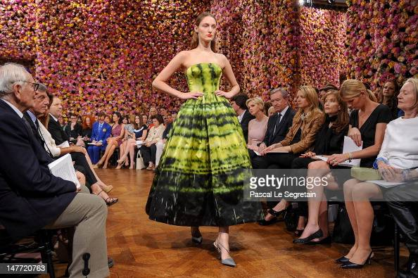 Princess Charlene of Monaco Bernard Arnault Delphine Arnault Isabelle Huppert and guests watch a model as she walks the runway during the Christian...
