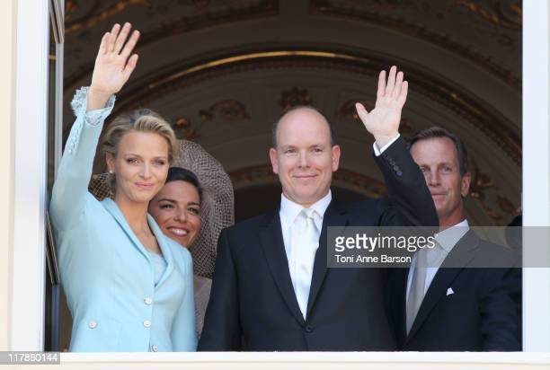 Princess Charlene of Monaco her witness Donatella Knecht de Massy Prince Albert II of Monaco and his witness Chris Le Vine pose on the balcony after...