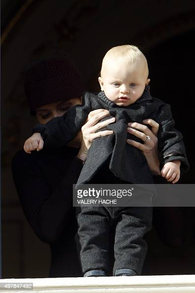 Princess Charlene of Monaco holding Prince Jacques appears on the balcony of the Monaco Palace during celebrations marking Monaco's National Day on...