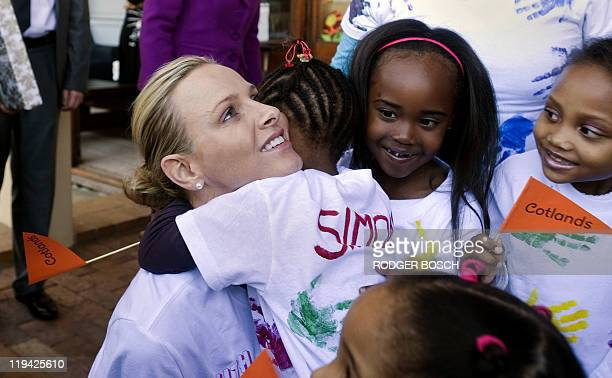 Princess Charlene of Monaco hugs a child during her visit to Cotlands a home for abandoned abused and very ill children in Strand about 50Km from the...