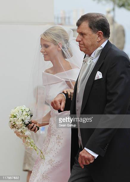 Princess Charlene of Monaco is accompanied by her father Michael Kenneth Wittstock at the religious ceremony of the Royal Wedding of Prince Albert II...