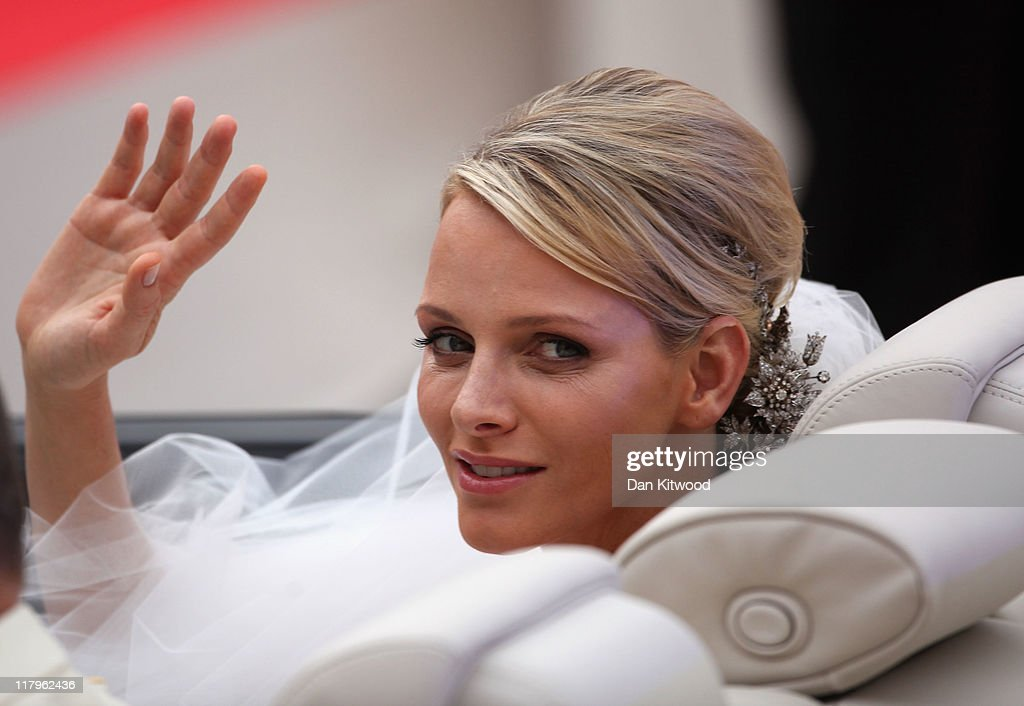 Princess <a gi-track='captionPersonalityLinkClicked' href=/galleries/search?phrase=Charlene+-+Princess+of+Monaco&family=editorial&specificpeople=726115 ng-click='$event.stopPropagation()'>Charlene</a> of Monaco makes her journey to Sainte Devote church after their religious wedding ceremony at the Prince's Palace of Monaco on July 2, 2011 in Monaco. The Roman-Catholic ceremony followed the civil wedding which was held in the Throne Room of the Prince's Palace of Monaco on July 1. With her marriage to the head of state of the Principality of Monaco, <a gi-track='captionPersonalityLinkClicked' href=/galleries/search?phrase=Charlene+-+Princess+of+Monaco&family=editorial&specificpeople=726115 ng-click='$event.stopPropagation()'>Charlene</a> Wittstock has become Princess consort of Monaco and gains the title, Princess <a gi-track='captionPersonalityLinkClicked' href=/galleries/search?phrase=Charlene+-+Princess+of+Monaco&family=editorial&specificpeople=726115 ng-click='$event.stopPropagation()'>Charlene</a> of Monaco. Celebrations including concerts and firework displays are being held across several days, attended by a guest list of global celebrities and heads of state.