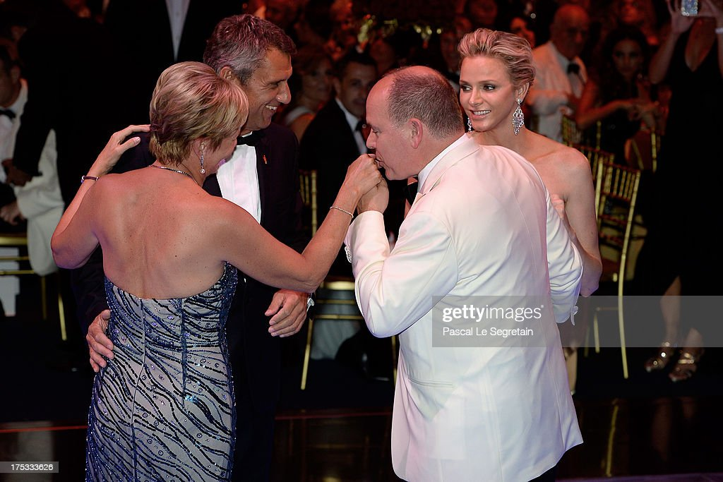 Princess Charlene of Monaco (R), Prince Albert II of Monaco (2nd R) and guests dance during the 65th Monaco Red Cross Ball Gala at Sporting Monte-Carlo on August 2, 2013 in Monte-Carlo, Monaco.