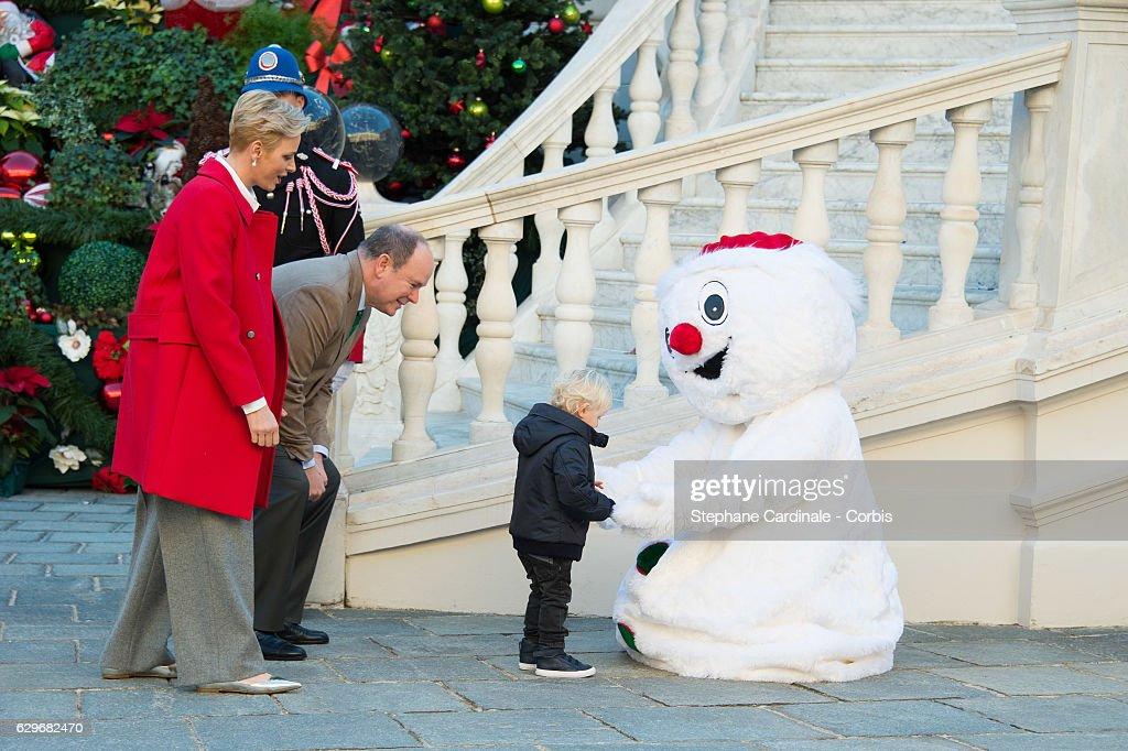Princess Charlene of Monaco, Prince Albert II of Monaco and Prince Jacques of Monaco attend the Christmas Gifts Distribution At Monaco Palace on December 14, 2016 in Monaco, Monaco.