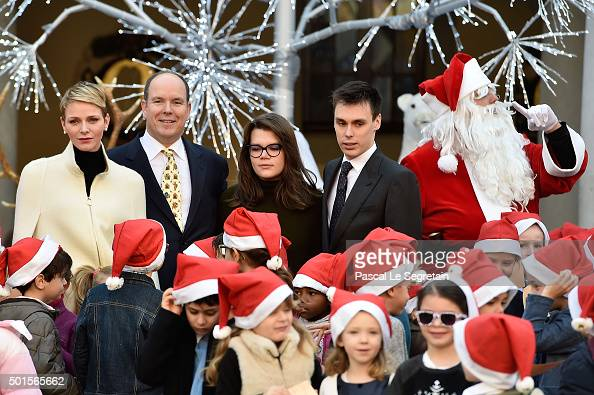 Princess Charlene of Monaco Prince Albert II of Monaco Camille Gottlieb and Louis Ducruet attend the Christmas gifts distribution on December 16 2015...
