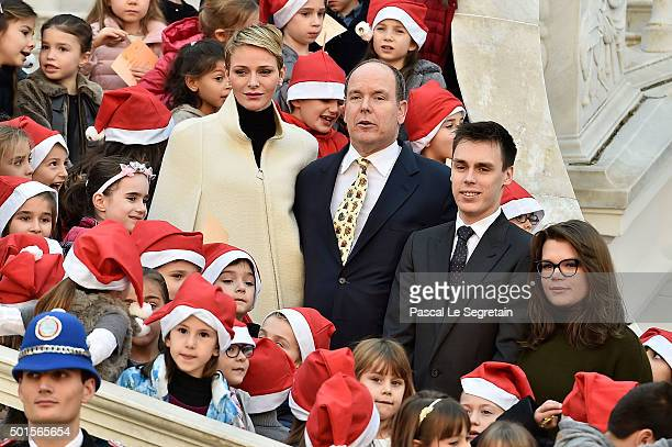 Princess Charlene of Monaco Prince Albert II of Monaco Louis Ducruet and Camille Gottlieb attend the Christmas gifts distribution on December 16 2015...