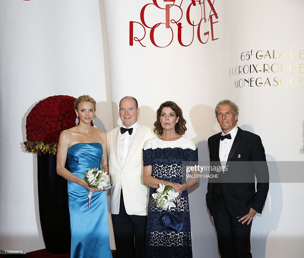 Princess Charlene of Monaco, Prince Albert II of Monaco, Princess Caroline of Hanover and Michael Bolton arrive to attend the 65th annual Red Cross Gala, on August 2, 2013, in Monaco. Created in 1948, the gala is an annual charity event held in Monaco by its Princely Family during the summer. AFP PHOTO / VALERY HACHE