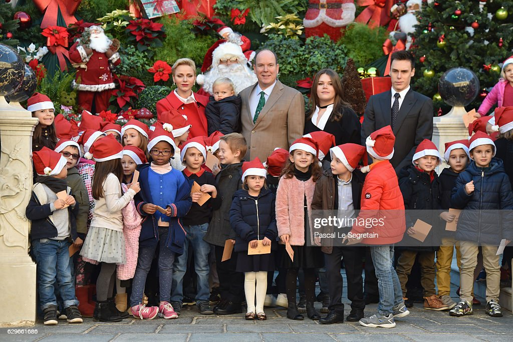 Princess Charlene Of Monaco, Prince Jacques of Monaco, Prince Albert II of Monaco, Camille Gottlieb and Louis Ducruet pose with children at the annual Christmas gifts distribution at Monaco Palace on December 14, 2016 in Monaco, Monaco.