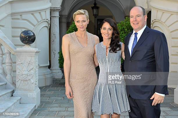 Princess Charlene of Monaco Robin Tunney and Prince Albert II of Monaco attend a cocktail party at the Monaco Palace on June 12 2013 in MonteCarlo...