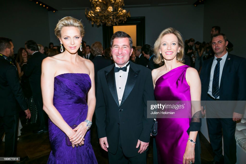 Princess Charlene of Monaco, U.S. Ambassador to France Charles H. Rivkin and his wife Susan Tolson attend the presentation of the Ralph Lauren Fall 13 Collection Show at Les Beaux-Arts de Paris on October 8, 2013 in Paris, France. On this occasion Ralph Lauren celebrates the restoration project and patron sponsorship of L'Ecole des Beaux-Arts.