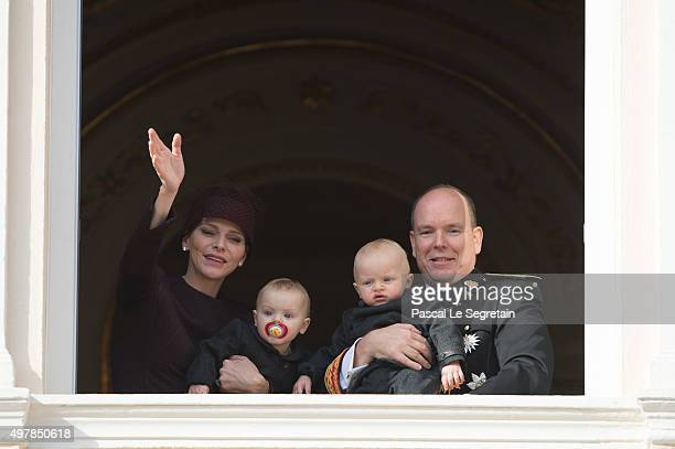 Princess Charlene of Monaco waves to the crowd as she attends the balcony apprearance of the National day celebrations with Princess Gabriella Prince...