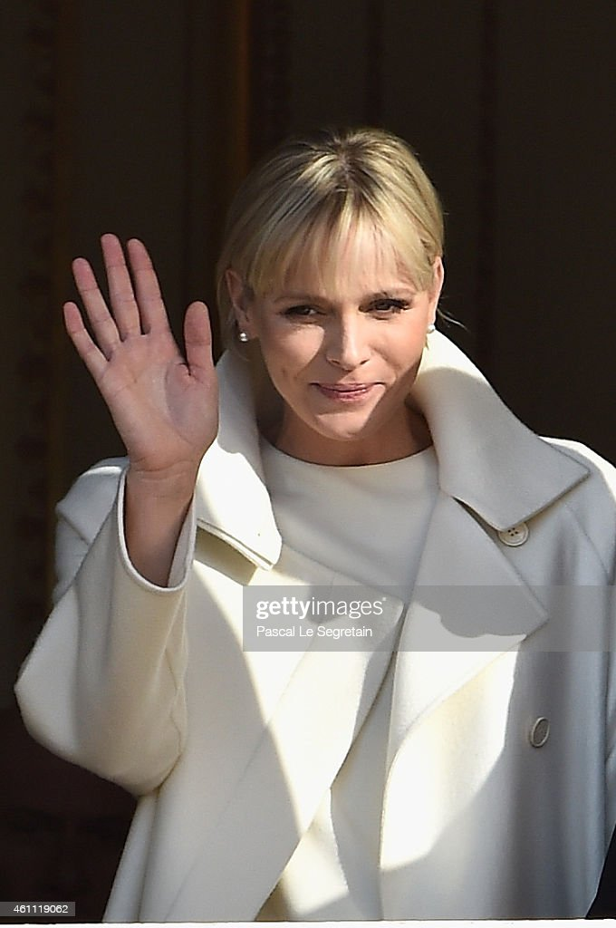 Princess Charlene of Monaco waves to the crowd during the official presentation of the Monaco twins on January 7, 2015 in Monaco, Monaco.