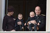 Princess Charlene of Monaco with Princess Gabriela and Prince Albert II of Monaco with Prince Jacques greet the crowd from the palace's balcony...