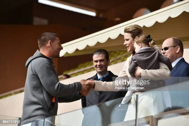 Princess Charlene of Monaco with Princess Gabriella of Monaco and Prince Albert II of Monaco greet a guest prior the Sainte Devote Rugby Tournament...