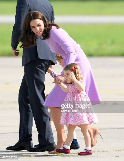 Princess Charlotte of Cambridge and Catherine Duchess of Cambridge view helicopter models H145 and H135 before departing from Hamburg airport on the...