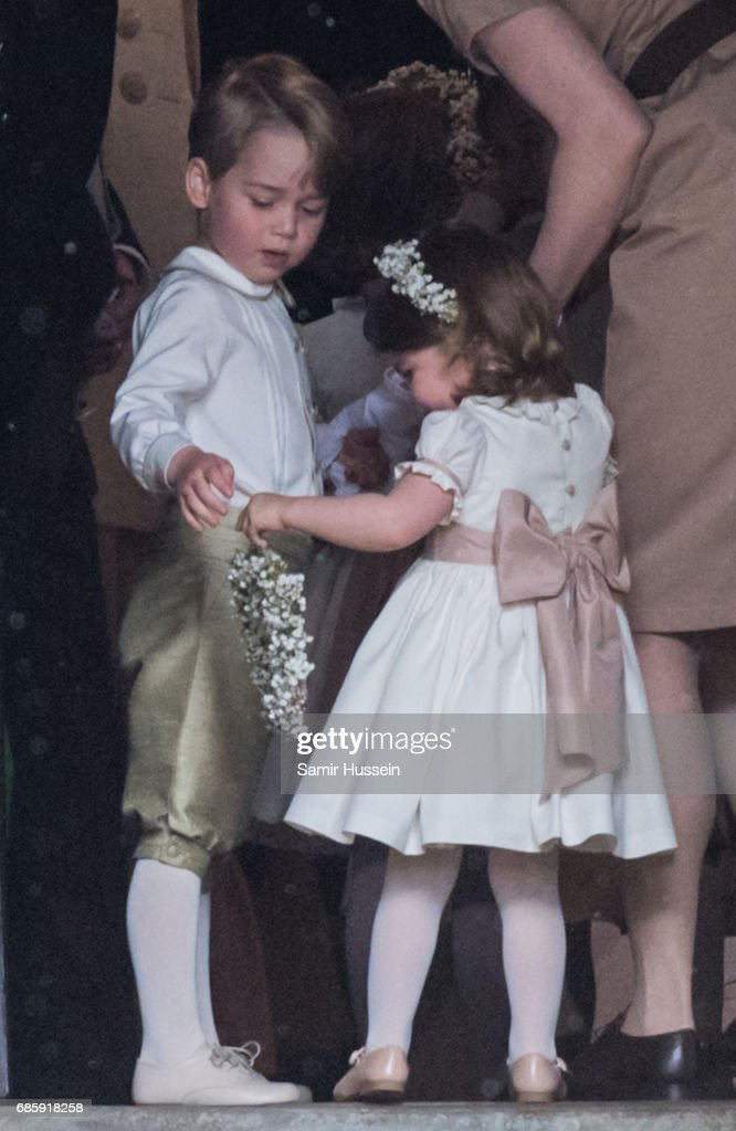 Princess Charlotte of Cambridge and Prince George of Cambridge attend the wedding Of Pippa Middleton and James Matthews at St Mark's Church on May 20, 2017 in Englefield Green, England.