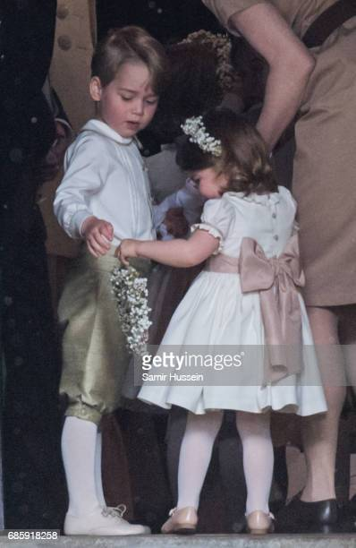 Princess Charlotte of Cambridge and Prince George of Cambridge attend the wedding Of Pippa Middleton and James Matthews at St Mark's Church on May 20...