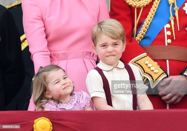 Princess Charlotte of Cambridge and Prince George of Cambridge look on from the balcony during the annual Trooping The Colour parade at the Mall on...