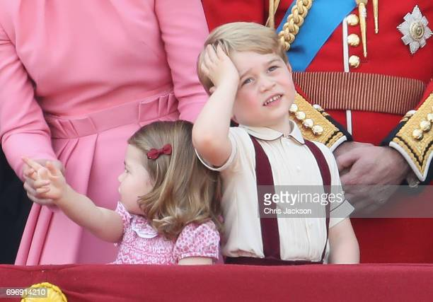 Princess Charlotte of Cambridge and Prince George of Cambridge look out from the balcony of Buckingham Palace during the Trooping the Colour parade...