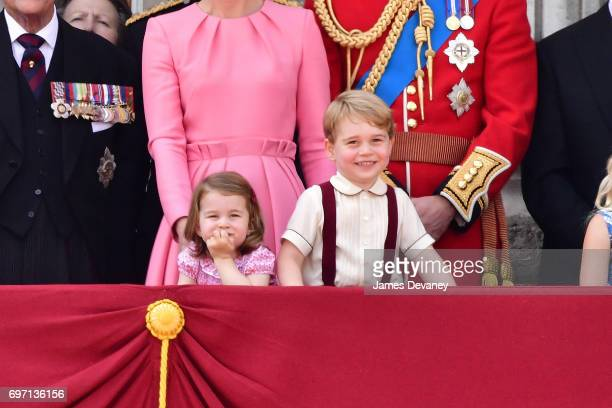 Princess Charlotte of Cambridge and Prince George of Cambridge stand on the balcony of Buckingham Palace during the Trooping the Colour parade on...