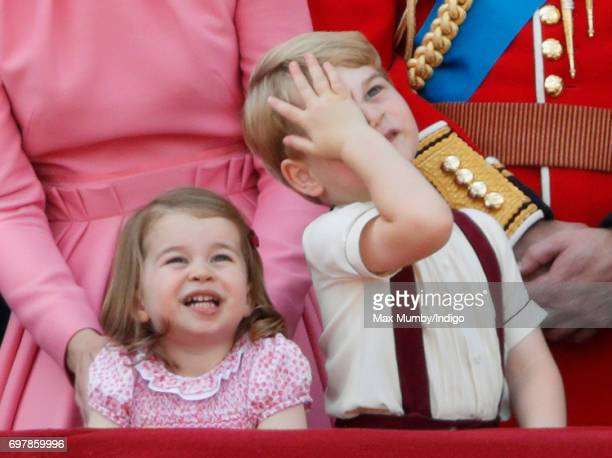 Princess Charlotte of Cambridge and Prince George of Cambridge watch the flypast from the balcony of Buckingham Palace during the annual Trooping the...