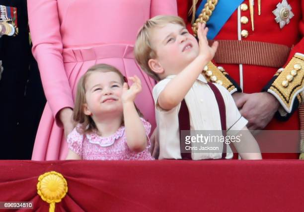 Princess Charlotte of Cambridge and Prince George of Cambridge wave from the balcony of Buckingham Palace during the Trooping the Colour parade on...