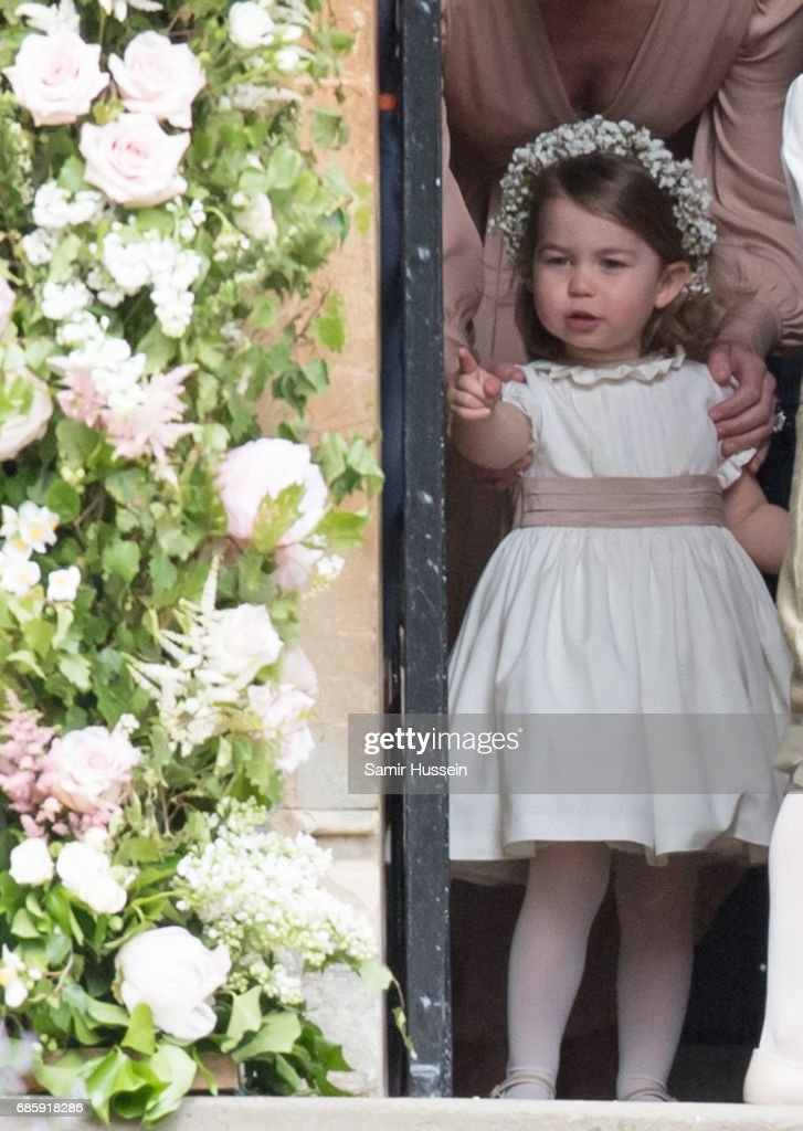 Princess Charlotte of Cambridge attends the wedding Of Pippa Middleton and James Matthews at St Mark's Church on May 20, 2017 in Englefield Green, England.