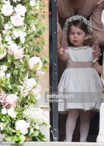 Princess Charlotte of Cambridge attends the wedding Of Pippa Middleton and James Matthews at St Mark's Church on May 20 2017 in Englefield Green...