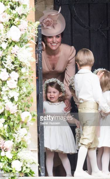 Princess Charlotte of Cambridge bridesmaid and Catherine Duchess of Cambridge arrive for the wedding Of Pippa Middleton and James Matthews at St...