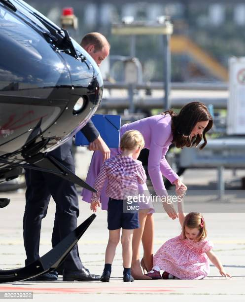 Princess Charlotte of Cambridge falls over and helped up by Catherine Duchess of Cambridge as they visited the Airbus factory during an official...
