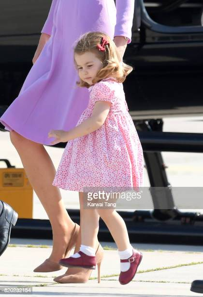 Princess Charlotte of Cambridge views helicopter models H145 and H135 before departing from Hamburg airport on the last day of their official visit...