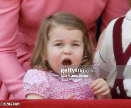 Princess Charlotte of Cambridge watches the flypast from the balcony of Buckingham Palace during the annual Trooping the Colour Parade on June 17...