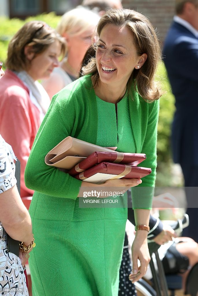 Princess Claire of Belgium smiles after attending the first communion of twin Princes Nicolas and Aymeric at the Sainte-Catherine church, on May 29, 2014, in Bonlez.