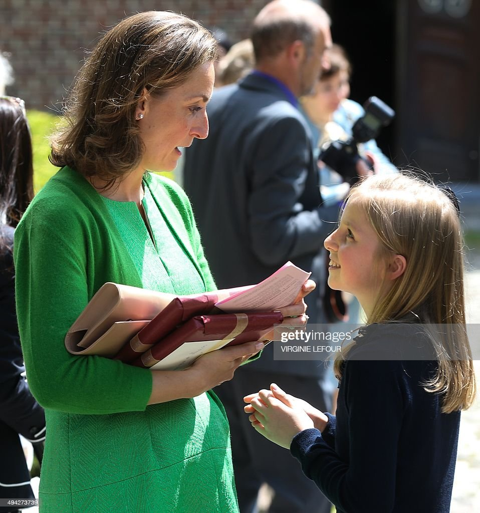 Princess Claire of Belgium (L) talks to her daughter Princess Louise after attending the first communion of twin Princes Nicolas and Aymeric at the Sainte-Catherine church, on May 29, 2014, in Bonlez. AFP PHOTO / BELGA / VIRGINIE LEFOUR