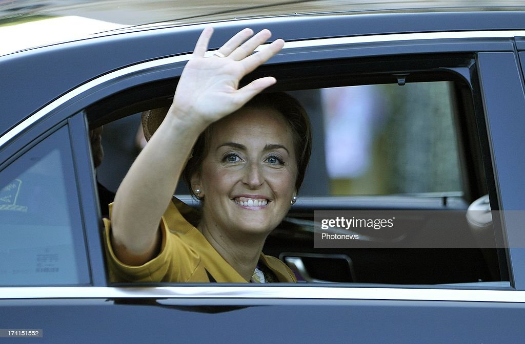 <a gi-track='captionPersonalityLinkClicked' href=/galleries/search?phrase=Princess+Claire+of+Belgium&family=editorial&specificpeople=215265 ng-click='$event.stopPropagation()'>Princess Claire of Belgium</a> waves to the crowd during the Abdication Of King Albert II Of Belgium & Inauguration Of King Philippe at the Cathedral of St. Michael and St. Gudula on July 21, 2013 in Brussels, Belgium.