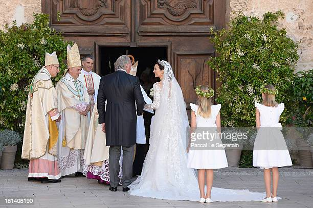 Princess Claire Of Luxembourg and her father Hartmut Lademacher are greeted by Most Reverend JeanClaude Hollerich Archbishop of Luxembourg Archbishop...