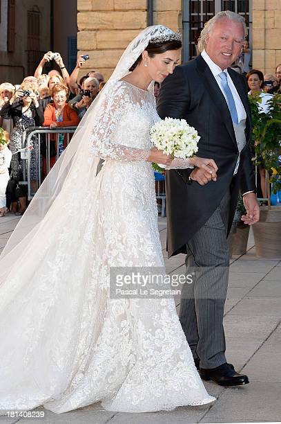 Princess Claire Of Luxembourg and her father Hartmut Lademacher arrive to the Religious Wedding Of Prince Felix Of Luxembourg and Claire Lademacher...