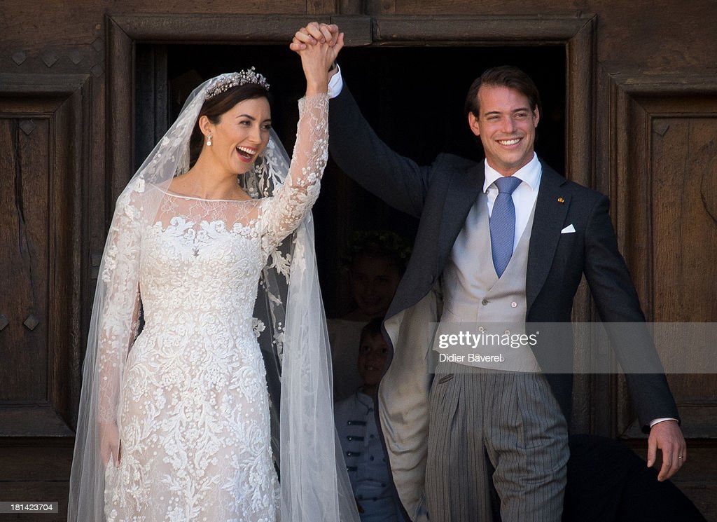 Princess Claire of Luxembourg and Prince Felix of Luxembourg depart their wedding ceremony at Basilique Sainte Marie-Madeleine on September 21, 2013 in Saint-Maximin-La-Sainte-Baume, France.